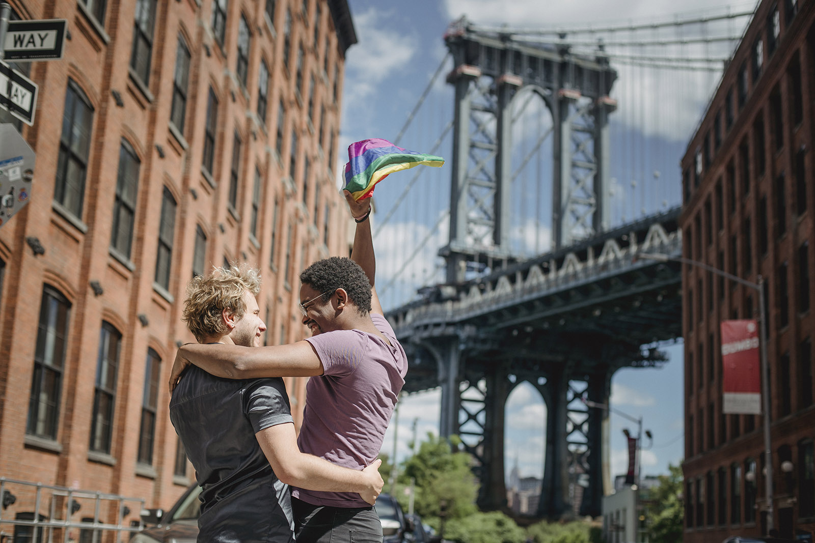 Happy couple holding up a Pride Flag in NYC.
